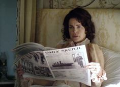 Cora reads about the Titanic in her favorite rag.