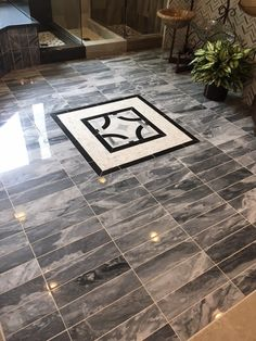 We are obsessed with this install of 4x16 marble with a medallion accent. This creates such an impact in any space. https://arizonatile.com/en/products/marble/bardiglio #marbletile #tilemedallion #aztile