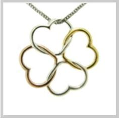 Tri Color Clover Necklace.  We love the interlocking hearts in the shape of a shamrock.