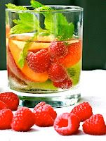 white sangria  2 Bottles of your Favourite White Wine (I used 1 bottle of Moscato)  2 Large Sliced Peaches  2 Kiwi Fruits   1 Cup of Blueberries  1 Cup of Raspberries  A handful of Mint Leaves  Sugar (I chose Stevia, natural sugar)  Ice      Simply add in all of the ingredients, give it a stir and let the flavours mix naturally for 5-10 minutes