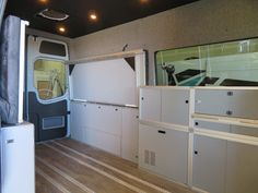 The Sprinter interior keeps things clear for transport and then folds and slides out at camp...