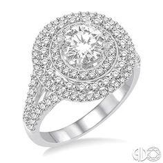 Triple Halo Diamond, round brilliant diamond Engagement Ring with a split shank.