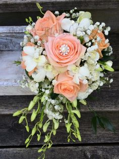 Cascading Bouquet. The gem in the middle of the Rose is so precious.