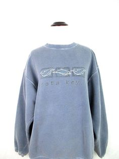1990s vintage Siesta Keys Florida distressed sweatshirt. Soft & comfy perfectly worn in heather blue/gray pigment dyed cotton pullover with dolphins on the front. Womens size medium. Please see measurements for best fit. *Brand: Classic Pigment* *Size: Womens Medium* *Fabric: