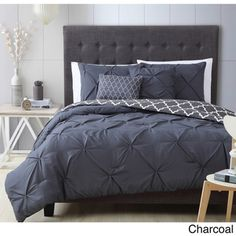 This elegant comforter set features a pintuck design on a solid color in a variety of options. Coordinating shams and decorative pillows finish the bedroom makeover. Set includes: One (1) comforter, t