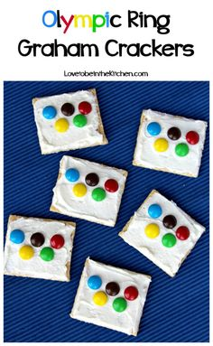 Olympic Ring Graham Crackers are easy and fun to make! All you need for this yummy recipe are graham crackers, buttercream frosting and M&M's!