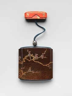 Inrō with Bird on a Blossoming Plum Tree, Koma Yasutada (Japanese), Edo period (1615–1868). Black lacquer and nashiji ground with gold and silver iroe togidashi maki-e; Netsuke: box with plovers; red lacquer ground with gold and brown hiramaki-e; Ojime: bead with flowers; shibuichi and enamel | The Metropolitan Museum of Art  #inro #Japanese_art