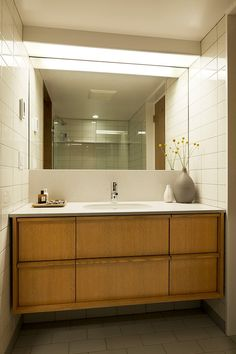 The mirrors went wall to wall in the 50's. Mid Century Flat Remodel by SHED Architecture & Design