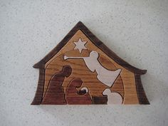 A Master of None: Christmas Creations--Wooden Puzzle Nativity  includes a pattern to cut your own with a scroll saw