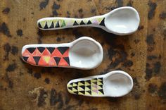 red and yellow geometric spoons