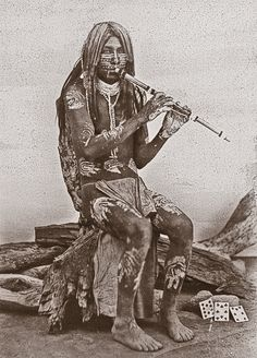 In the Yuma tradition, young men courted sweethearts by playing the flute. Isaiah West Taber photographed this Yuma musician from Arizona in San Francisco, California, circa 1885.  – Courtesy Library of Congress –