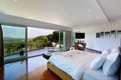 Hotels & Resort, Stunning Villa With Interior Design In White Scheme Wooden Bed White Mattress Ceiling Wall Black Tv Bedside Table Laminate Floor Curtain Glass Window: Phuket Villa with Awesome Skylines and Luxurious Interior Decor