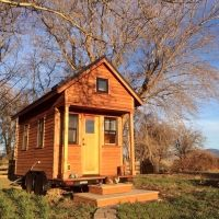 See how couple went debt-free by living tiny. Their uncluttered house is terrific Morning View, Debt Free, Cozy Living, Tiny House, Photo Galleries, Cabin, House Styles, Gallery, Homes