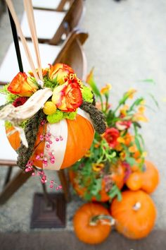 Pretty pumpkin pomanders. Such a simple combination of pumpkins, ribbons, and flowers makes such beautiful decor for a fall wedding!