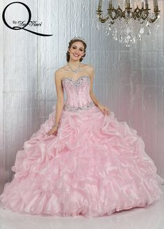 Q by DaVinci Style #: 80279 Two-piece shimmer organza dress features sweetheart strapless neckline and beaded corset style bodice.  Skirt is accented with pick-ups and horizontal layers.   Lace up back. Includes jacket.