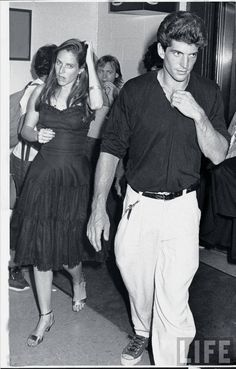 """""""John F. Kennedy Jr. ® and girlfriend, actress Christina Haag arriving at Madison Square Garden for Madonna's benefit performace for amFAR. (1987) """""""