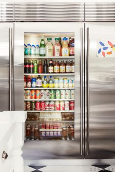 Stainless steel refrigerator with glass door front.