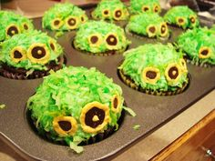 Hobbit Hole Cupcakes!  I began with gluten free devils food cake and filled them with a homemade coconut cream pie filling. Each cupcake got a healthy smear of chocolate ganache.   I piped on some green-tinted, coconut-scented buttercream.   And dipped each one in green and yellow coconut shreds.