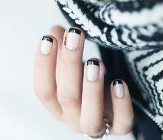 Black French Tips with a neutral pink and rhinestone pinpoints of light at the bottom. Love! Essie Fed Up