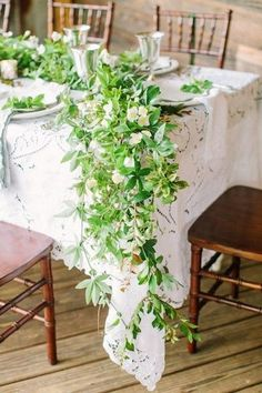 I like the greenery with bunches of baby's breath along the actual table, and perhaps some marsala flowers?