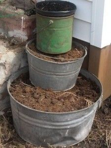 A way to make a tiered garden from buckets and tubs