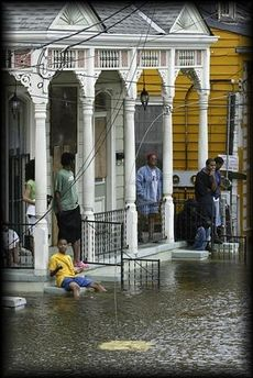 August 29, 2005 | Hurricane Katrina | The Treme neighborhood of New Orleans, showing people trapped in their homes.