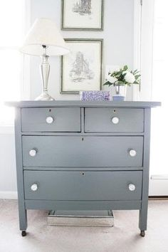 Paint my chest of drawers grey with white porcelain knobs.