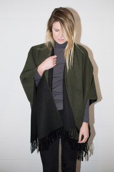 The perfect Fall/Winter accessory. This wool-feel two toned poncho scarf, available in four color combos (and an awesome stripe!) is the perfect comprise between a scarf and a sweater. Drape it over y