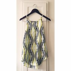 Tribal Print Blouse Flowy beautiful tribal print blouse in mint yellow white and black. Great over shorts or white pants perfect for spring and summer. No brand or size tag it was cut off. Fits like a s/m Tops Tank Tops