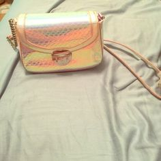 Nine West Crossbody Purse Lightly used Nine West cross body purse. It's a shiny reflective light pink color, very pretty. Nice for a night out. Light wear on the Crossbody strap. Willing to negotiate the price! Nine West Bags Crossbody Bags