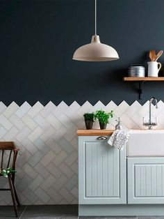 New ways to use tiles at home White metro kitchen tiles used as herringbone tiles against a navy wall with powder blue kitchen cupboards from RedOnline Kitchen Tiles Design, Kitchen Wall Tiles, Kitchen Flooring, Kitchen Backsplash, Backsplash Ideas, Tile Ideas, White Tile Kitchen, Colourful Kitchen Tiles, Metro Tiles Kitchen