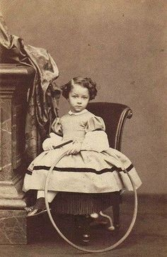 A tintype from the 1860s. What a doll!