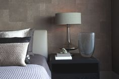 Different textures on walls and in fabrics is looking interesting and dynamic . Layering similar tones across different texures makes this space classy.