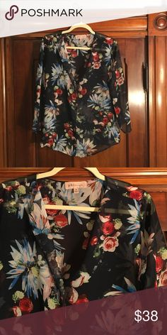 philosophy floral top This floral top is sheer and beautiful. Quarter sleeves and weightless material let you move around on a nice spring day. Philosophy Tops Blouses
