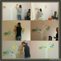 Painting her wall