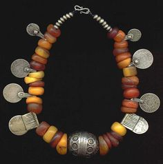 Tuareg amber necklace with talismanic silver coins and beads. 19th or early 20th century. I love the sheer boldness of tribal jewellery like this...and the totemic qualities that it carries with it....