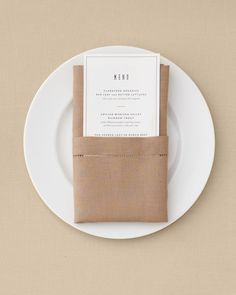 Slip a menu, place card, single bud, or set of utensils into this sleek pouch.