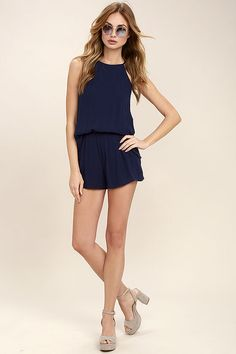 Travel to the Grand Canyon and beyond with the Olive & Oak Canyon Companion Navy Blue Romper to keep you company! A billowing sleeveless bodice, composed of woven poly, meets an elasticized waist and fluttering shorts with side pockets. Back keyhole meets a line of fabric-covered buttons.