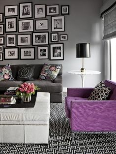 Grey walls, purple accent chair, and photo collage. Love it!
