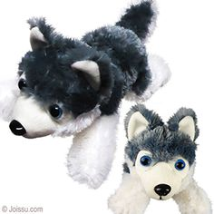 PLUSH LAYING DOWN HUSKIES. With bright blue button eyes, a button nose and beautiful grey and white fur, these husky dogs will delight any stuffed animal collector. Perfect for party favors.  Size 10 Inches