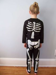 DIY skeleton costume. All you need is freezer paper and white fabric glue