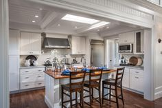 "This charming kitchen is the ideal space for meal prep, entertaining and even dining. ""This whole room is so beautiful in the detailing and the trim,"" explains the home's interior designer Linda Woodrum. ""And I think that's really important to notice."""