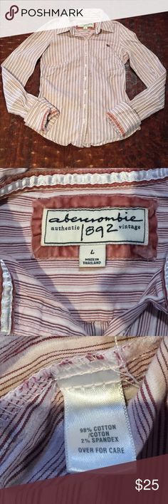 """Abercrombie Authentic Vintage Button Down Shirt Large (juniors) Abercrombie Authentic Vintage Long Sleeve Button Down Shirt. Shirt is 20"""" from shoulder to hem. Bust measures 14"""" laying flat. Shirt is in excellent condition with no signs of wear. Comes from a Smoke Free/Pet Friendly Home. Offers always welcome. Abercrombie & Fitch Tops Button Down Shirts"""