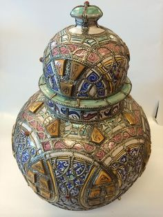 Magnificent Moroccan Antique Terracota  Lidded jar Hand Painted in a traditional Moroccan Mosaik style and   inlaid Dye Polished & Carved Camel Bone accents   the bowl is decorated in a embossed metalwork  intrincated design