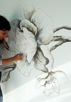 incrustation des mosaïques dans la peinture, et mise en teinte de celle-ci.