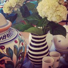 #blackandwhitestripes get all dressed up with fresh white hydrangeas. #potterylove