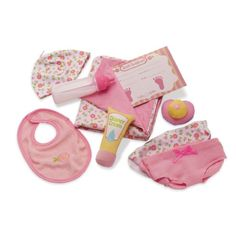 This adorable gift set has all of the newborn baby essentials you need to bring Baby Stella home.  Set includes receiving blanket, hat, two diapers, diaper cream, magnetic pacifier, magnetic milk bottle, bib and a birth certificate - everything needed for little ones to role play and nurture their very own Baby Stella Doll.  Baby Stella by Manhattan Toy is an ideal first baby doll collection that will encourage little ones to role play, nurture, and care.  Baby Stella dolls, sold…