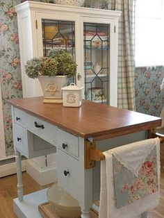 old desk turned into an island...might need this once I talk hubby into taking out the island to make room for my vintage sink :)