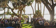gorgeous sun light during wedding ceremony under the trees at bay preserve at osprey. Sarasota wedding photographer