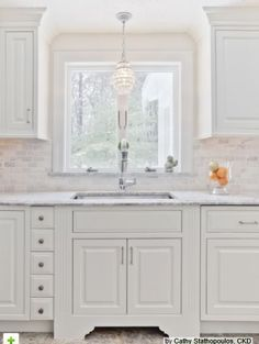 Simple white kitchen,love the light fixture  houzz.com